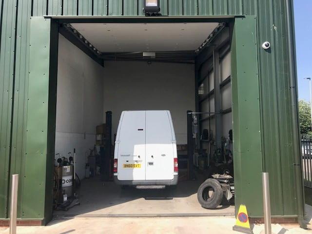 badger van hire garage with white van inside